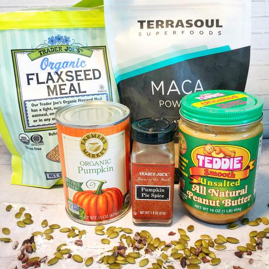 flaxseeds pumpkin maca peanut butter pumpkin pie spice on a counter