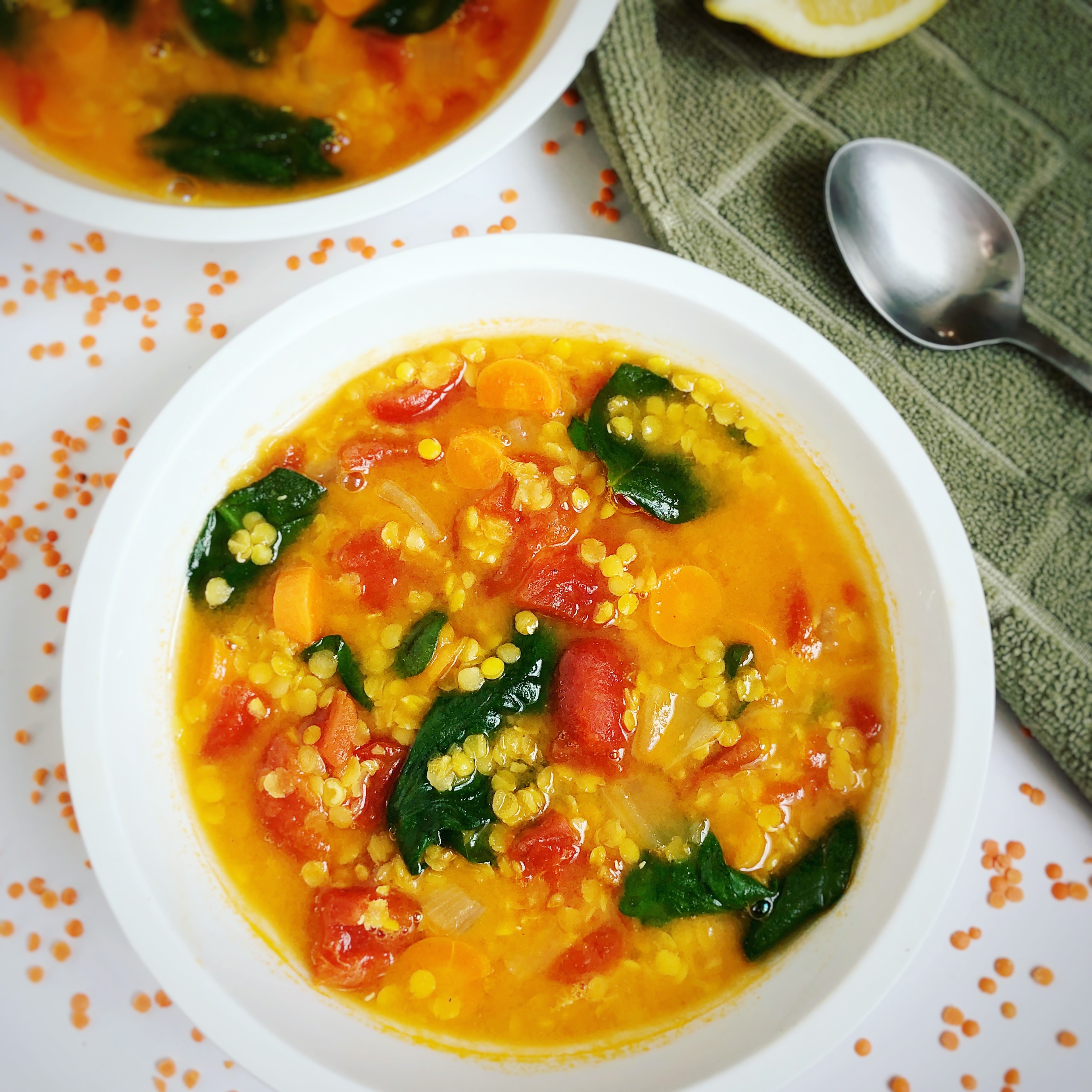 red lentil soup with spinach in 2 bowls